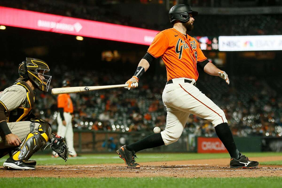 San Francisco Giants first baseman Brandon Belt (9) swings and misses against the San Diego Padres in the fifth inning during an MLB game at Oracle Park, Friday, May 7, 2021, in San Francisco, Calif.