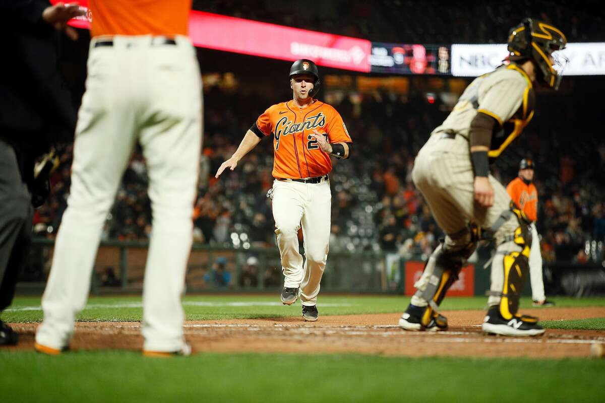 Giants catcher Buster Posey makes it to home on Evan Longoria's single Friday night.
