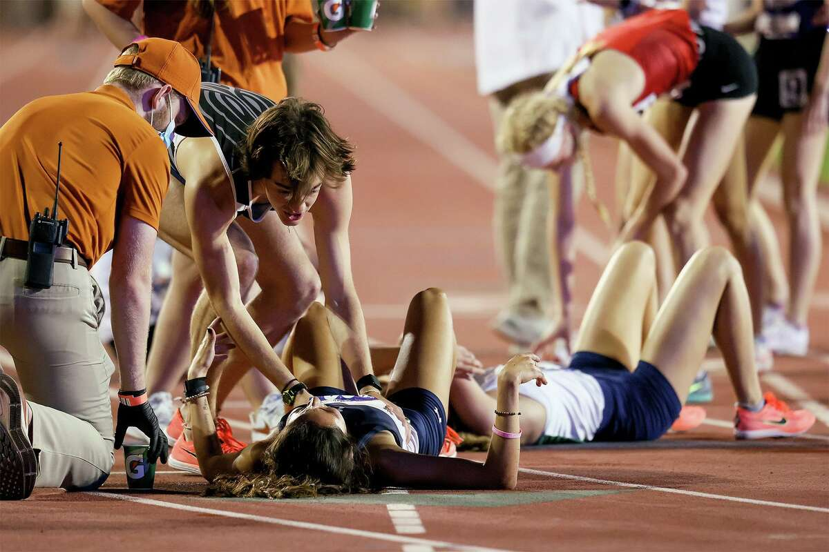 Boerne Champion's Foster Wilfong, second from left, congratulates teammate Anastacia Gonzales, on the ground, after she won the 5A girls 1600-meter run in the UIL state track and field championships at Mike A. Myers Stadium in Austin on Friday, May 7, 2021. Gonzales won the event with a time of 4:49.11.