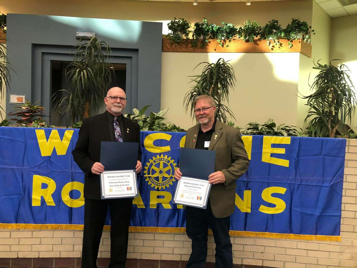 Plainview Rotarians Jay Givens (left) and Leslie Gattis are pictured following special recognitions received at the District Conference by the Plainview Rotary Club. Rotary Assistant Governor Gattis was recognized as Rotarian of the Year for Rotary District 5730 and Immediate Past President Givens received the award for Area 5 Best Club.