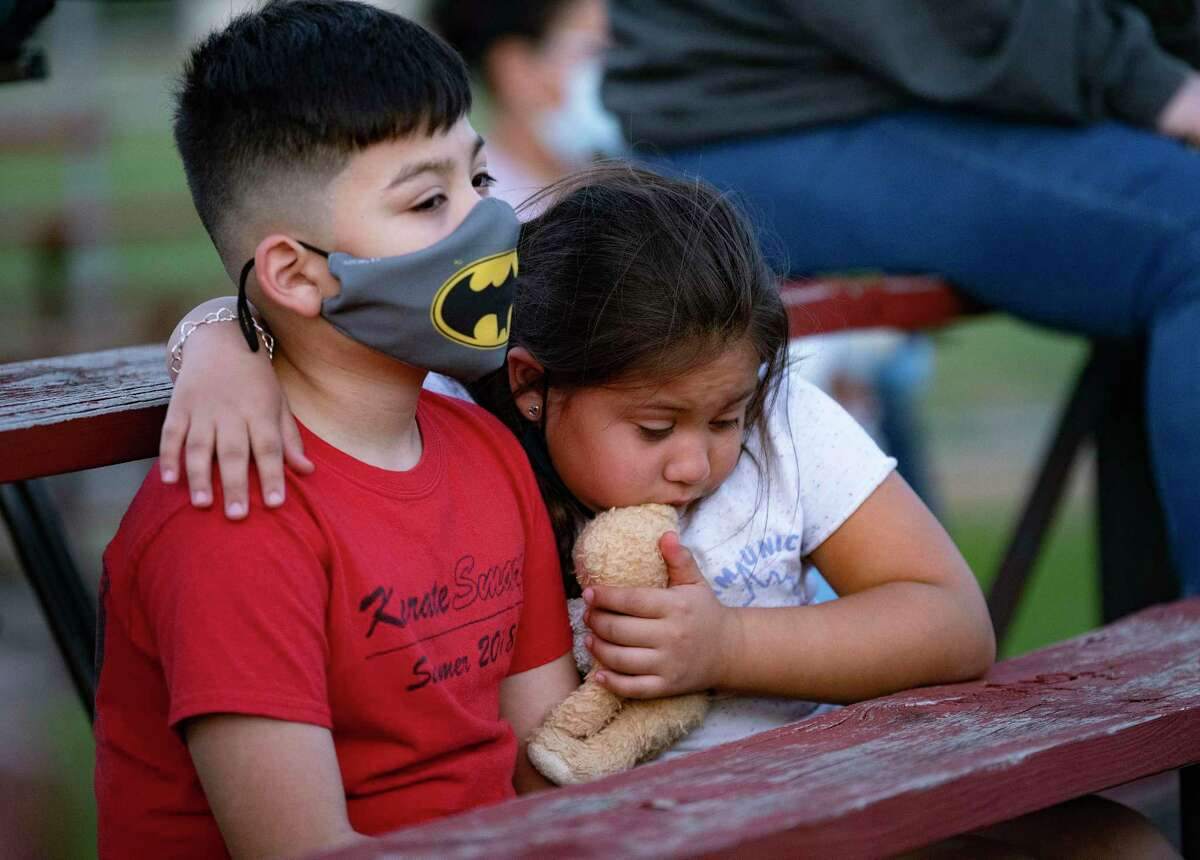 Elijah Gonzales, 10, and his sister, Amaris, 7, comfort one another Friday, May 7, 2021, during a vigil for James Avi Chairez, who's been missing for months. a