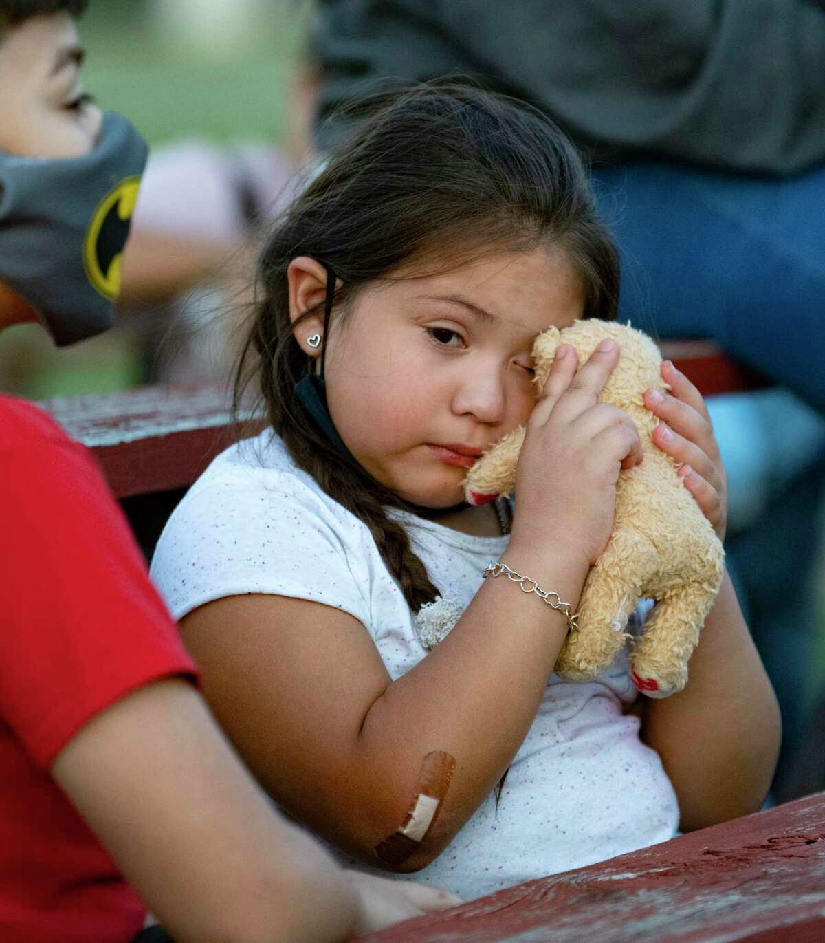 Amaris Gonzales, 7, wipes away a tear during a vigil for James, who was last seen Jan. 4. Human remains were found on April 28 at James' home. DNA results are pending.