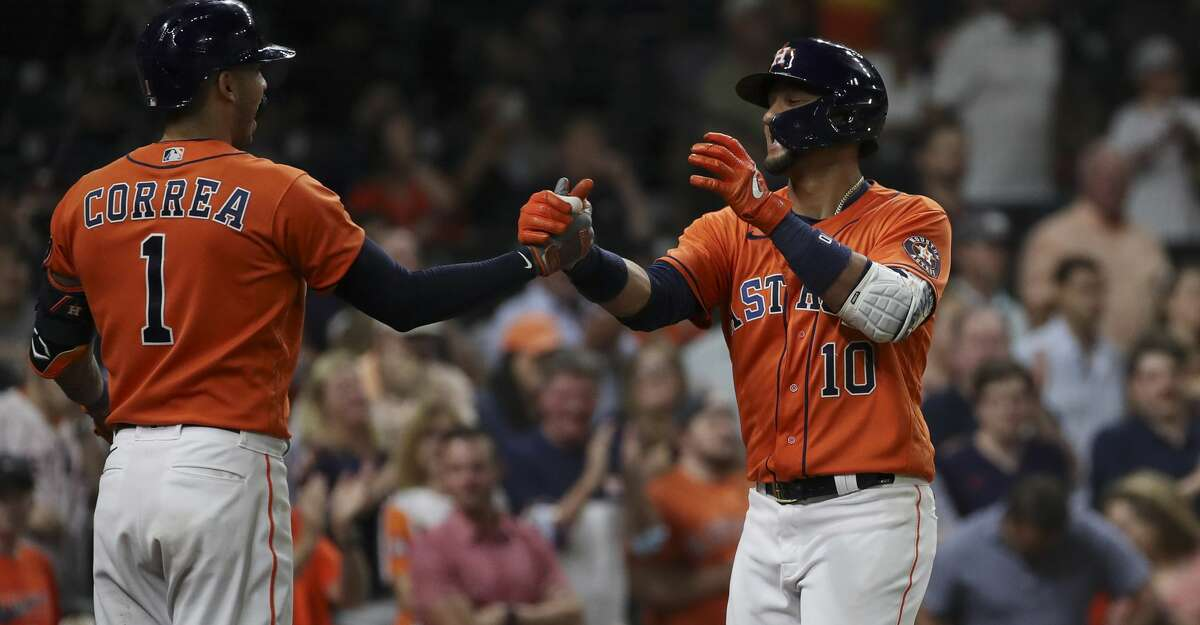 Houston Astros first baseman Yuli Gurriel (10) celebrates with shortstop Carlos Correa (1) after he hit a home run during the fifth inning of an MLB game Friday, May 7, 2021, at Minute Maid Park in Houston.