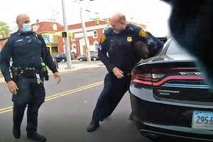 Body camera footage shows Sgt. Sean Lynch, right, restraining a suspect during an arrest last Sunday.