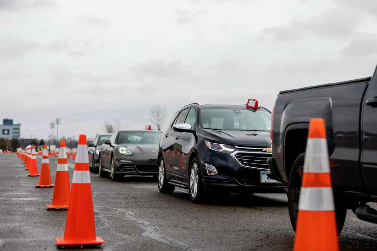 The 10-lane set up for Covid-19 vaccinations on the former Pratt & Whitney Runway at Rentschler Field in East Hartford, Conn. in a file photo from March 2021.