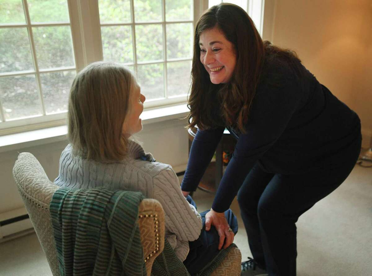 Holly Batti, of Ridgefield, spends time with her mother, Gwenn Fiorito, in memory care at Greens at Cannondale in Wilton, Conn. on Wednesday, May 5, 2021.