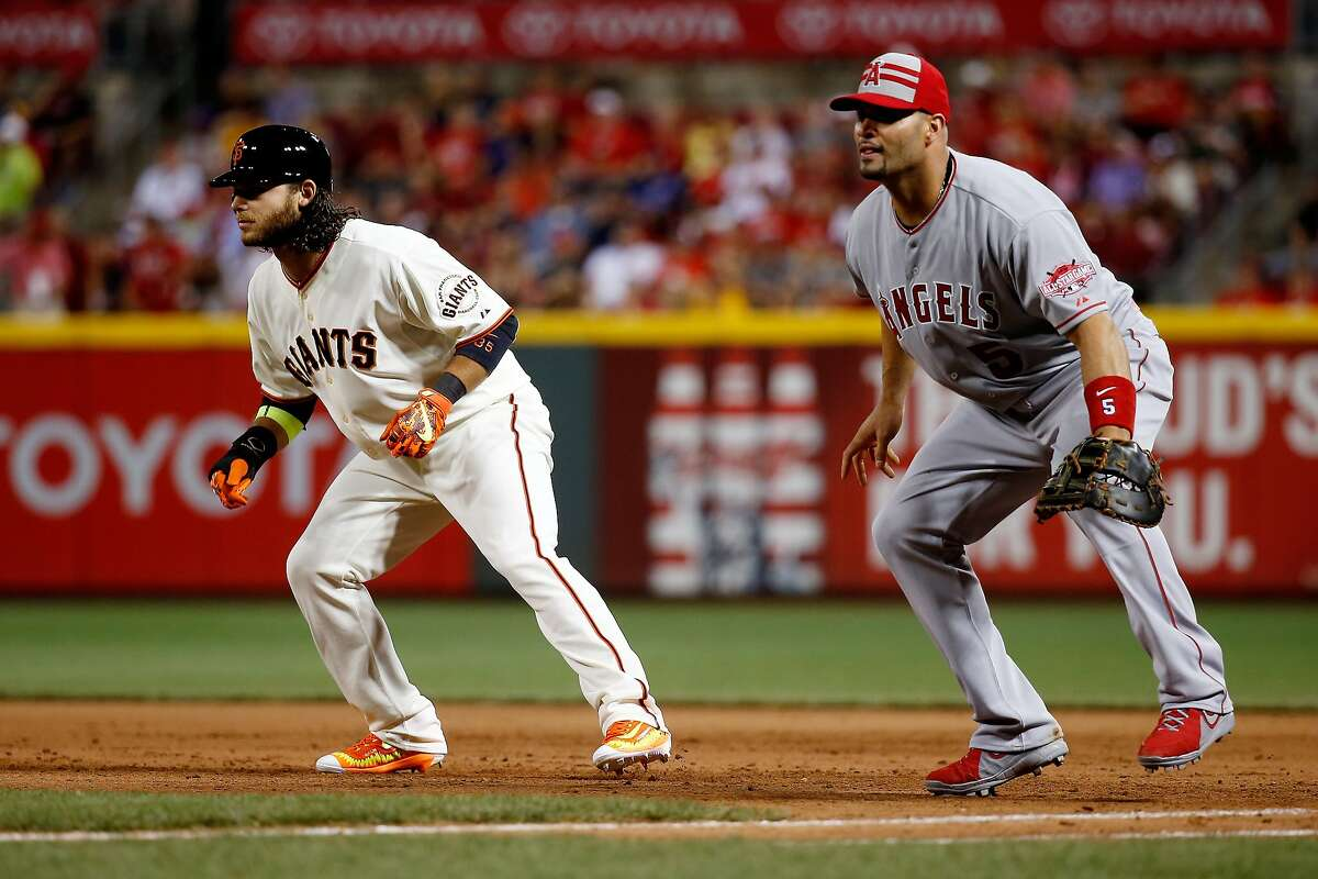 CINCINNATI, OH - JULY 14: National League All-Star Brandon Crawford #35 of the San Francisco Giants takes a lead off first base against American League All-Star Albert Pujols #5 of the Los Angeles Angels of Anaheim during the 86th MLB All-Star Game at the Great American Ball Park on July 14, 2015 in Cincinnati, Ohio. (Photo by Rob Carr/Getty Images)