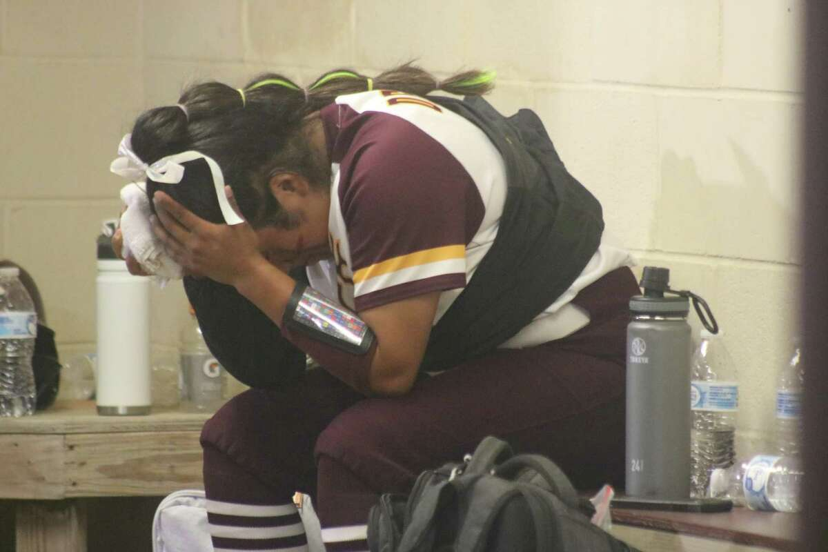 Deer Park pitcher Hannah Benavides keeps to herself in the dugout, wondering how many more innings can she keep Pearland off the scoreboard Friday night. She got the win with seven gritty innings.