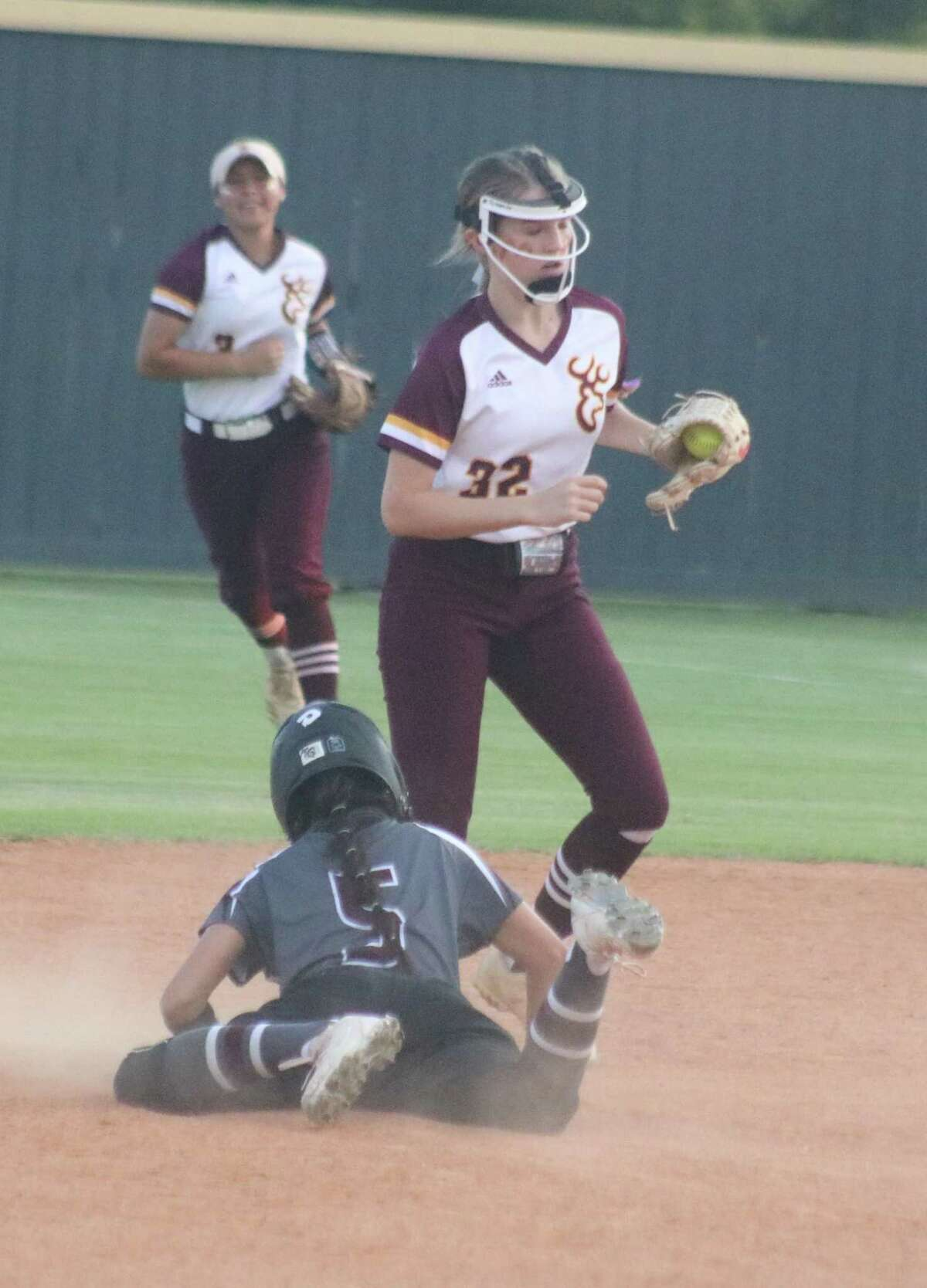 Deer Park shortstop Madison Bailey (32) completes a 9-6 double play in the fourth as the team took advantage of a Lady Oiler mental lapse on the basepaths. Linda Gobea started the twin-killing with a catch in right field.