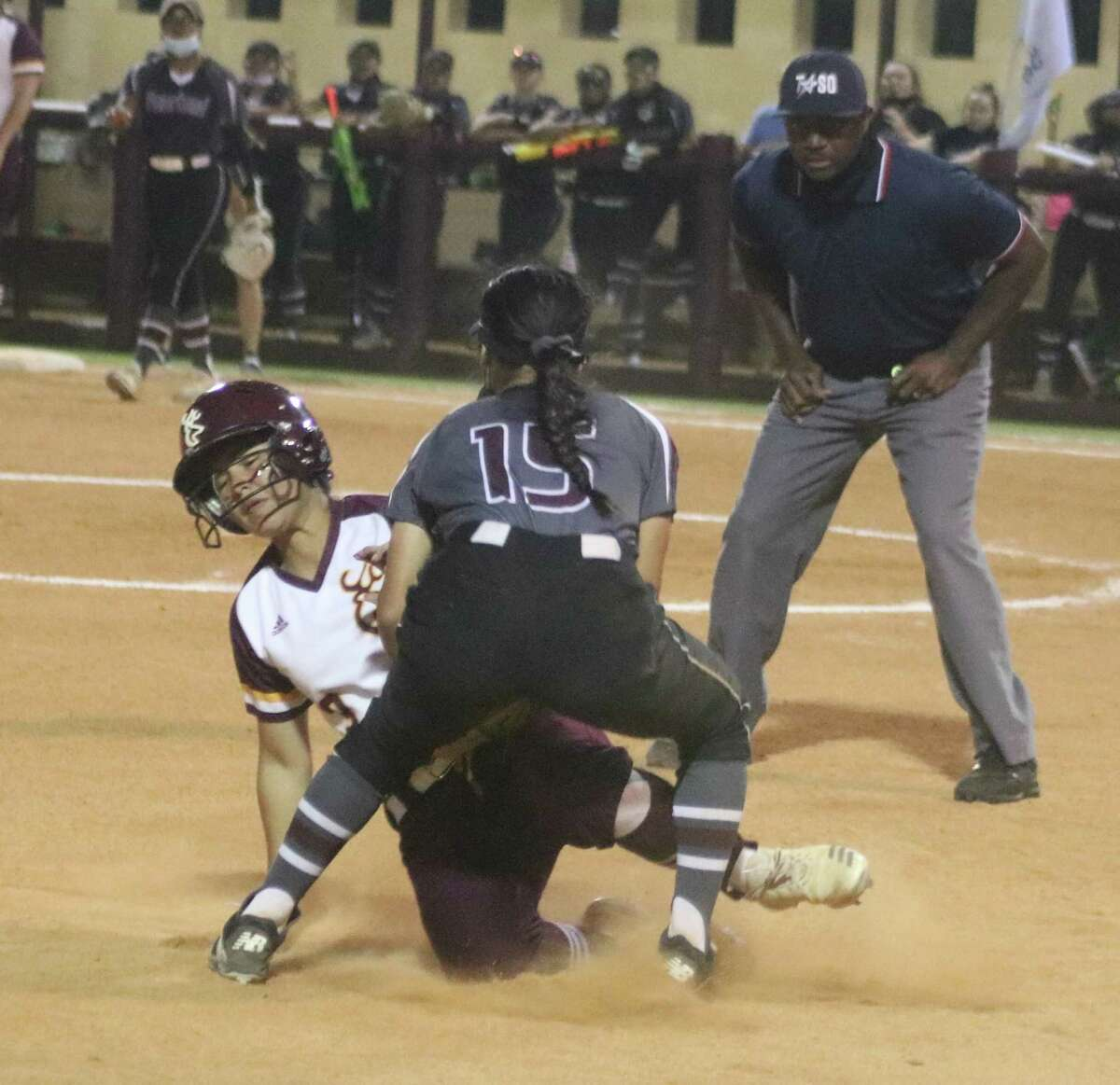 Deer Park's Linda Gobea is tagged out by Pearland's third baseman during sixth inning action Friday night. Gobea was attempting to become Deer Park's first runner to reach third base.