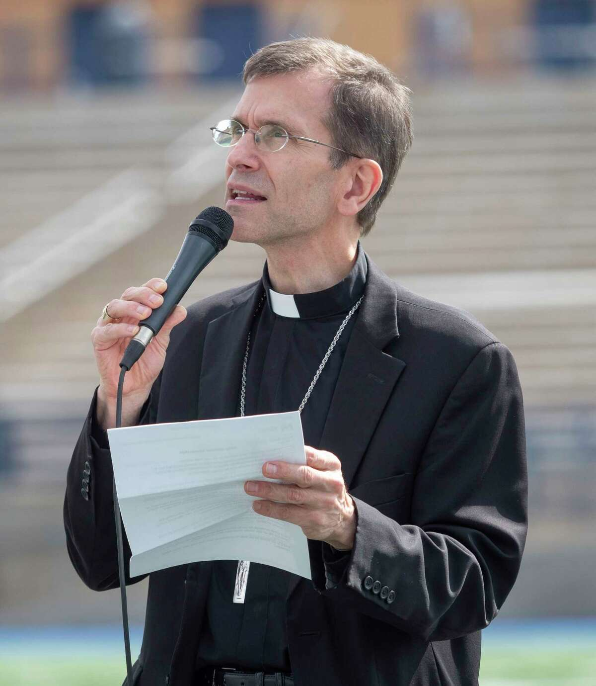 Bishop Sis leads everyone in prayer 05/08/2021 at the Celebration of Life activities at Grande Communications Stadium. Tim Fischer/Reporter-Telegram