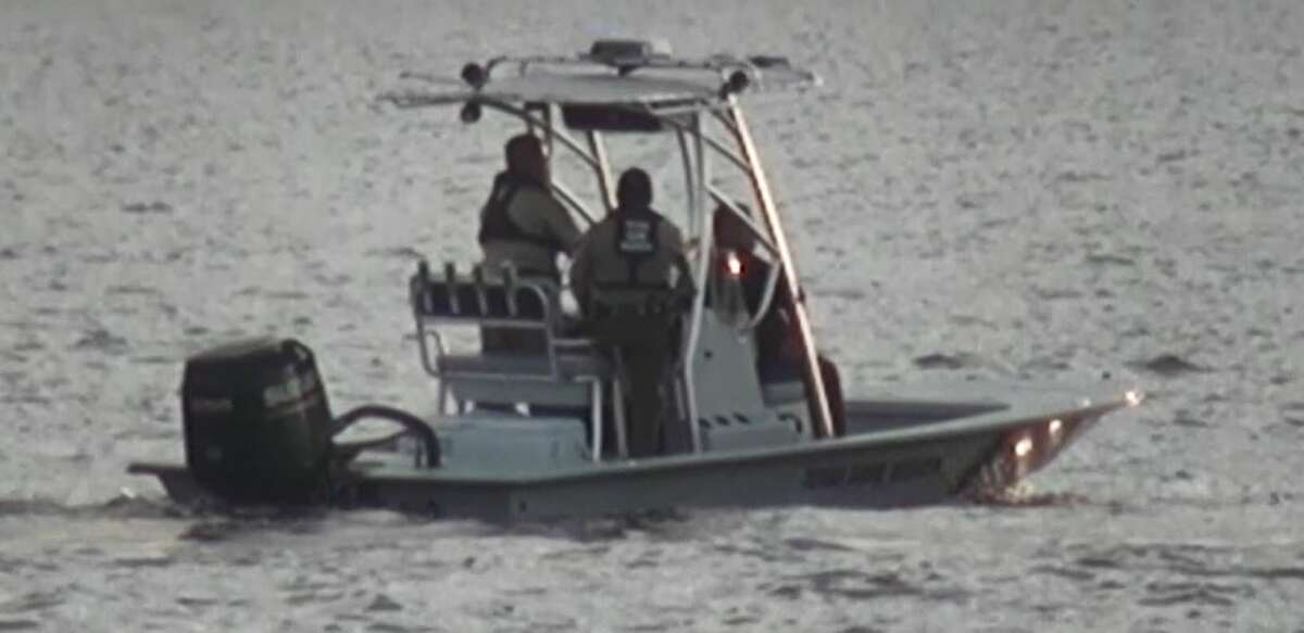 Authorities search for a couple who drowned in Lake Conroe Friday evening.