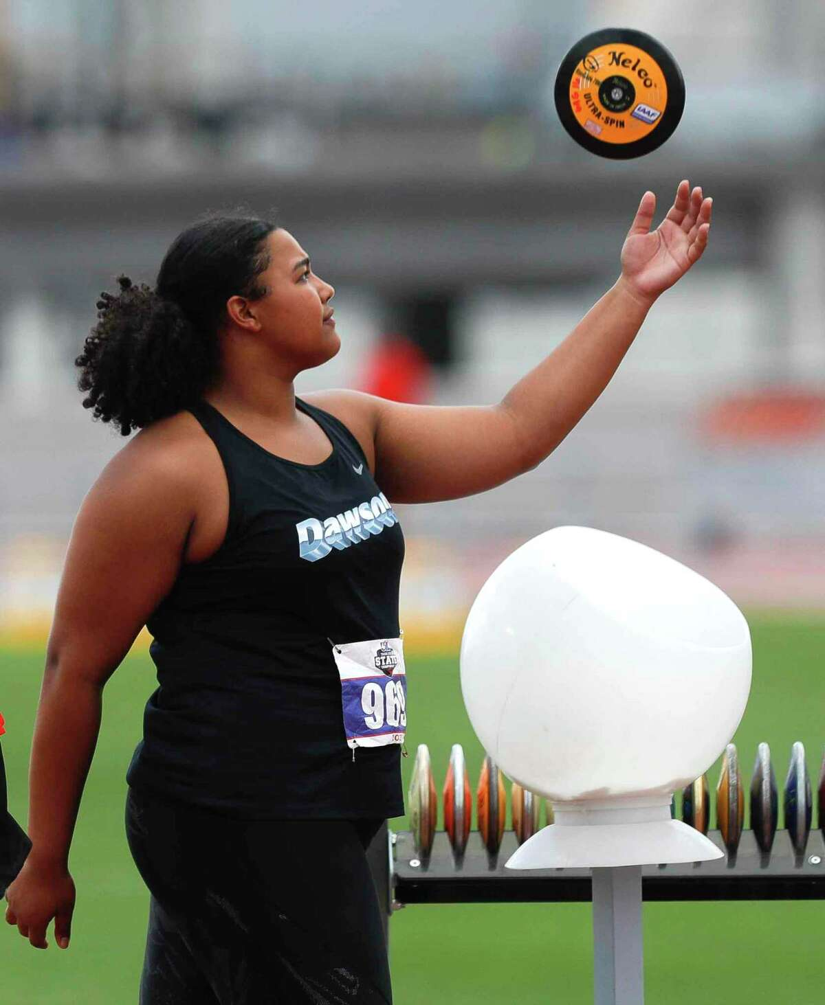 Chrystal Herpin of Dawson tosses a discus while waiting to throw at the Class 6A UIL Track and Field Championships Saturday at Mike A. Myers Stadium in Austin.