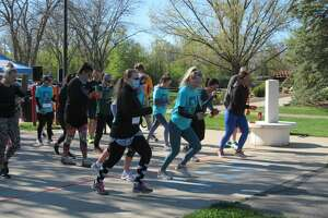 Runners and walkers begin Self Love Beauty's Confidence Starts Here 5k Run/Walk on Saturday, May 8, 2021 in Downtown Midland.
