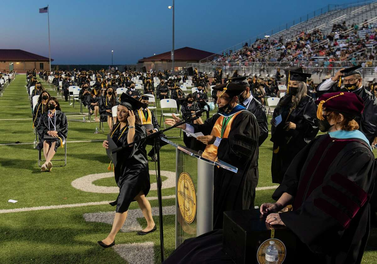 Laredo College graduates line up to receive their diploma on Friday, May 7, 2021 at the UISD Student Activity Complex.