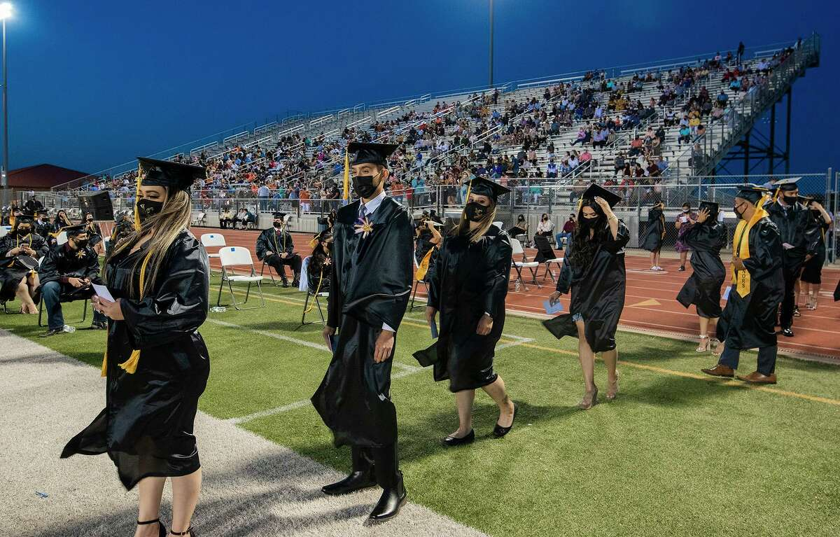 Laredo College graduates line up to receive their diploma, Friday, May 7, 2021, at the UISD Student Activity Complex.