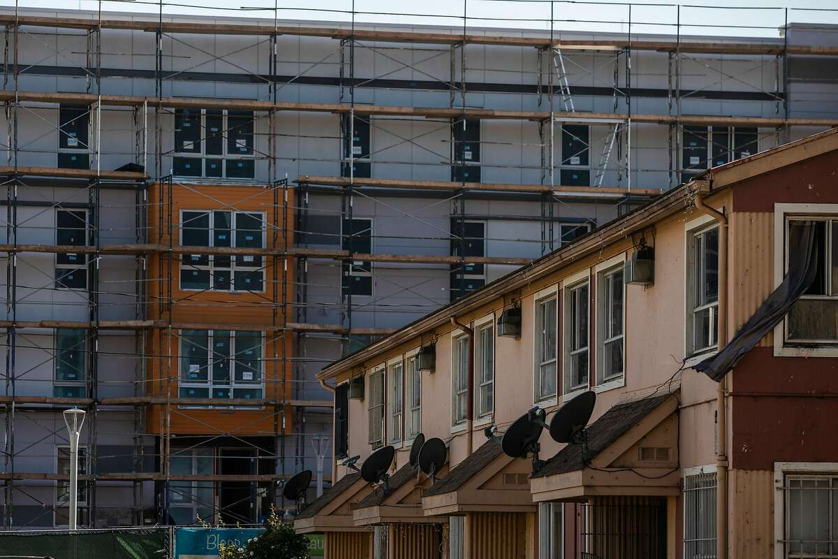 A multi-story housing construction is seen next to the public housing projects in the Sunnydale neighborhood of San Francisco, Calif. May 3, 2021.