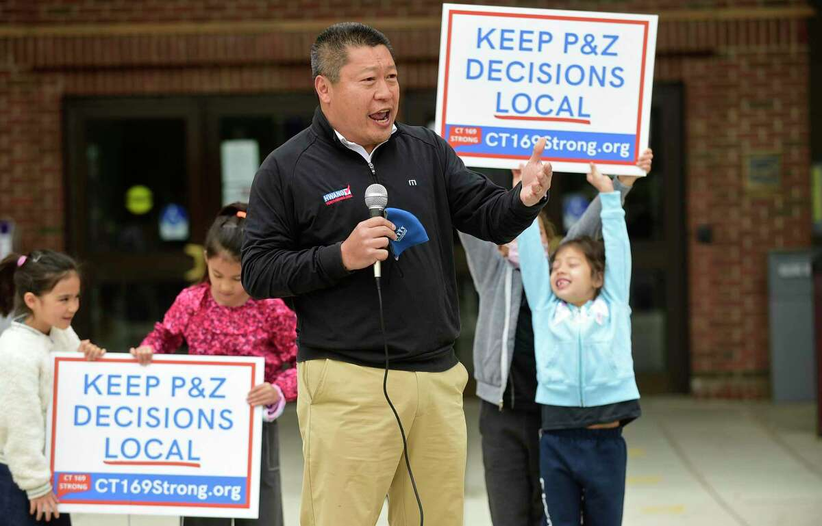 State Sen. Tony Hwang and others take part in the Hands Off Our Zoning rally outside City Hall in Norwalk on Saturday. against HB6611 Fair Share Bill & SB1024 Desegregate bill gather Saturday, May 8, 2021, at City Hall in Norwalk, Conn.