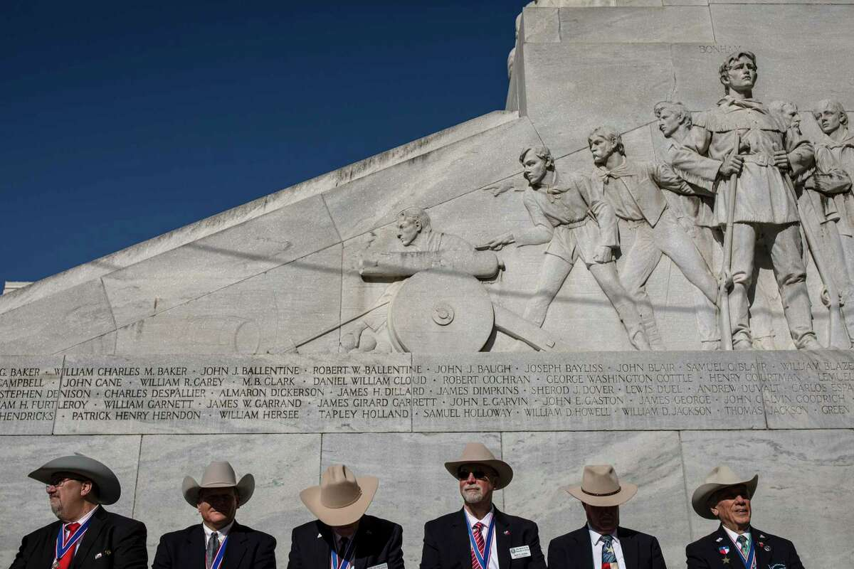 Members of the Sons of the Republic of Texas, a lineage society for descendants of the state's founders, gather beneath the Cenotaph monument on Alamo Plaza in March 2020.