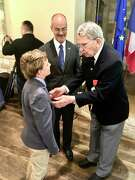 Retired Air Force Lt. Col. John C. Taylor, right, talks with his grandson, Carter John Taylor, 11, of Port Isabel as French Consul General Alexis Andres watches in the background.