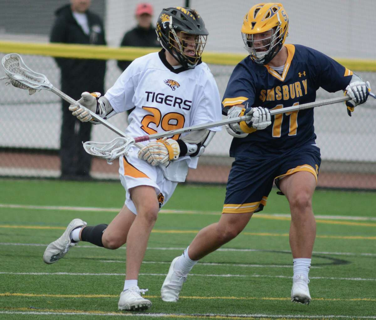 Hand's Ryan Collins, left, is defended by Simsbury's Aidan Boeshans on Saturday.