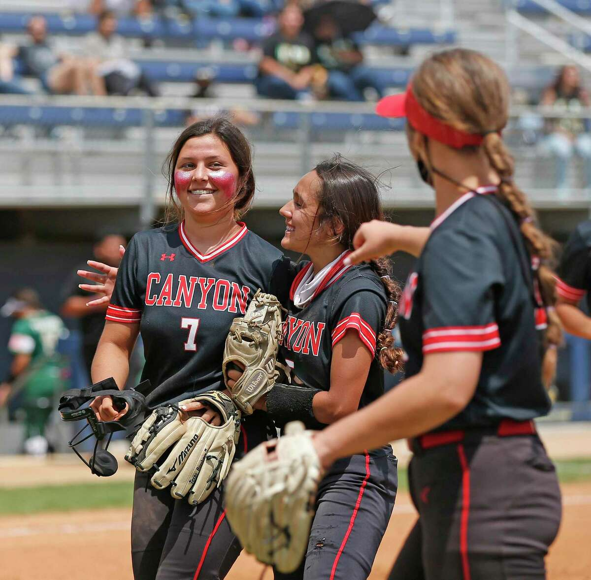 Canyon Bella Mitchell #7 is congratulated by teammates after striking out the batter to end the third inning. Softball playoff Game 2 of best of 3 between New Braunfels Canyon and Southwest Legacy on Saturday, May 8, 2021 at St. Mary's University.