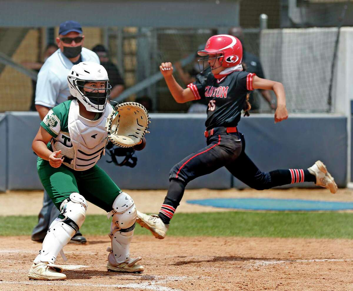 Canyon Haley Carmona #15 easily scores in the sixth inning as Southwest Legacy Alyssa Pena #9 waits for the thorn. Softball playoff Game 2 of best of 3 between New Braunfels Canyon and Southwest Legacy on Saturday, May 8, 2021 at St. Mary's University.