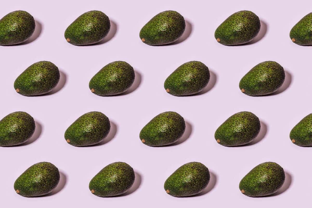 Avocado pattern over pink background.