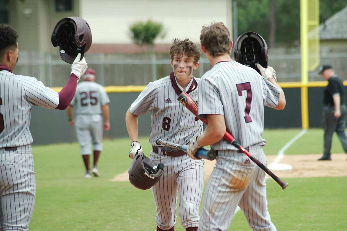 Pearland's Caden Ferraro (8) is congratulated by teammates Cameron Ponce (6) and Cain Landry (7) after hitting a home run against Clear Brook Saturday at Clear Brook High School.