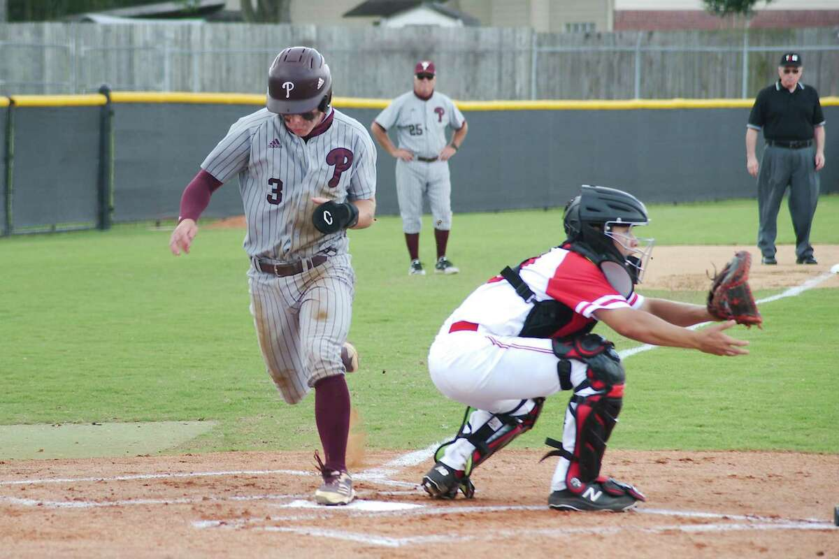 Pearland's Carter Allen (3) sprints to beat the throw to the plate in the Oilers' 8-3 win over Clear Brook Saturday in a Class 6A baseball playoff game.