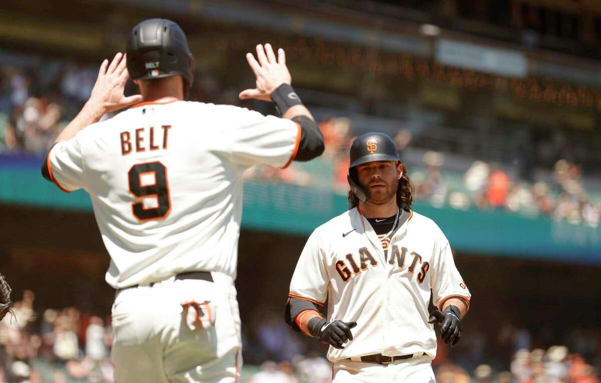 SAN FRANCISCO, CALIFORNIA - MAY 08: Brandon Crawford #35 of the San Francisco Giants is congratulated by Brandon Belt #9 after he hit a three-run home run in the second inning against the San Diego Padres at Oracle Park on May 08, 2021 in San Francisco, California. (Photo by Ezra Shaw/Getty Images)