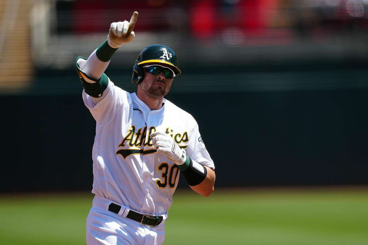 OAKLAND, CALIFORNIA - MAY 08: Austin Allen #30 of the Oakland Athletics celebrates a solo home run during the second inning against the Tampa Bay Rays at RingCentral Coliseum on May 08, 2021 in Oakland, California. (Photo by Daniel Shirey/Getty Images)