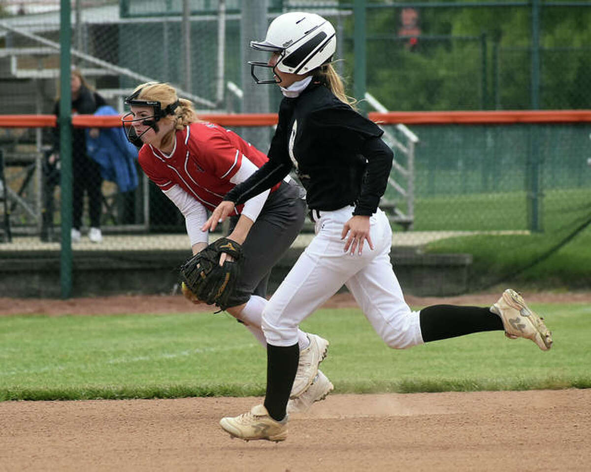 Edwardsville's Maci McNamee runs in front of Alton shortstop Reese Piont as she fields a ball in the second inning of Saturday's game inside the District 7 Sports Complex in Edwardsville.