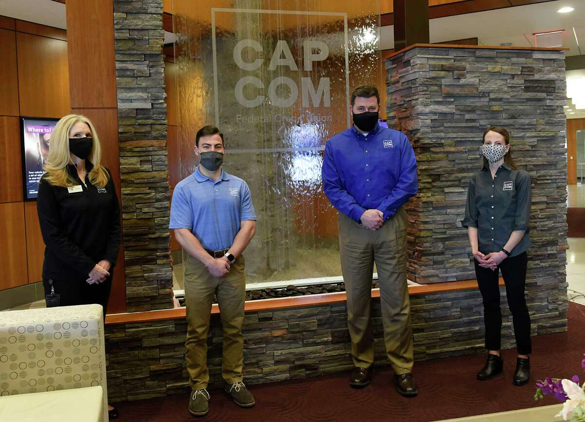 Employees, from left, Nicolle Monast, Jack Ainsley, Graig Furlong, Theresa Trietiak stand in at CAP COM headquarters on Thursday, April 22, 2021 in Albany, N.Y. CAP COM is one of the Top Workplaces. (Lori Van Buren/Times Union)