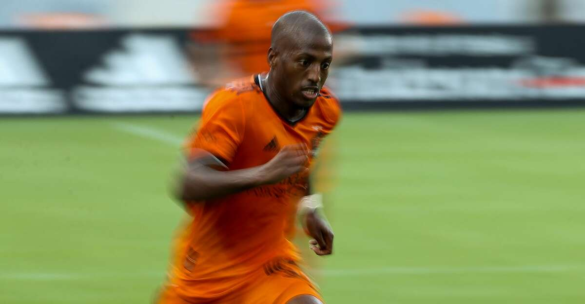 Houston Dynamo FC forward Fafa Picault (10) dribbles the ball upfield against the Los Angeles FC during the second half of an MLS match at BBVA Stadium on Saturday, May 1, 2021, in Houston. The game ended 1-1.