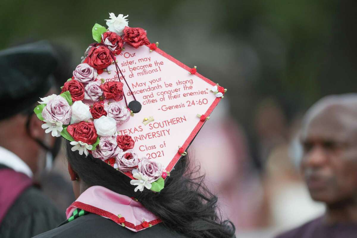 A graduate wears a decorated graduate hat during Texas Southern University's Spring 2021 commencement at Alexander Durley Stadium Saturday, May 8, 2021, in Houston.