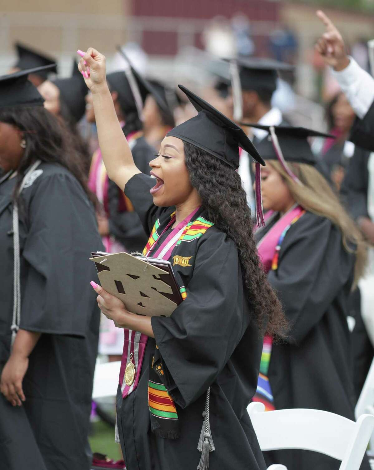 Siete Richardson cheers after graduating in Texas Southern University's Spring 2021 commencement at Alexander Durley Stadium Saturday, May 8, 2021, in Houston.