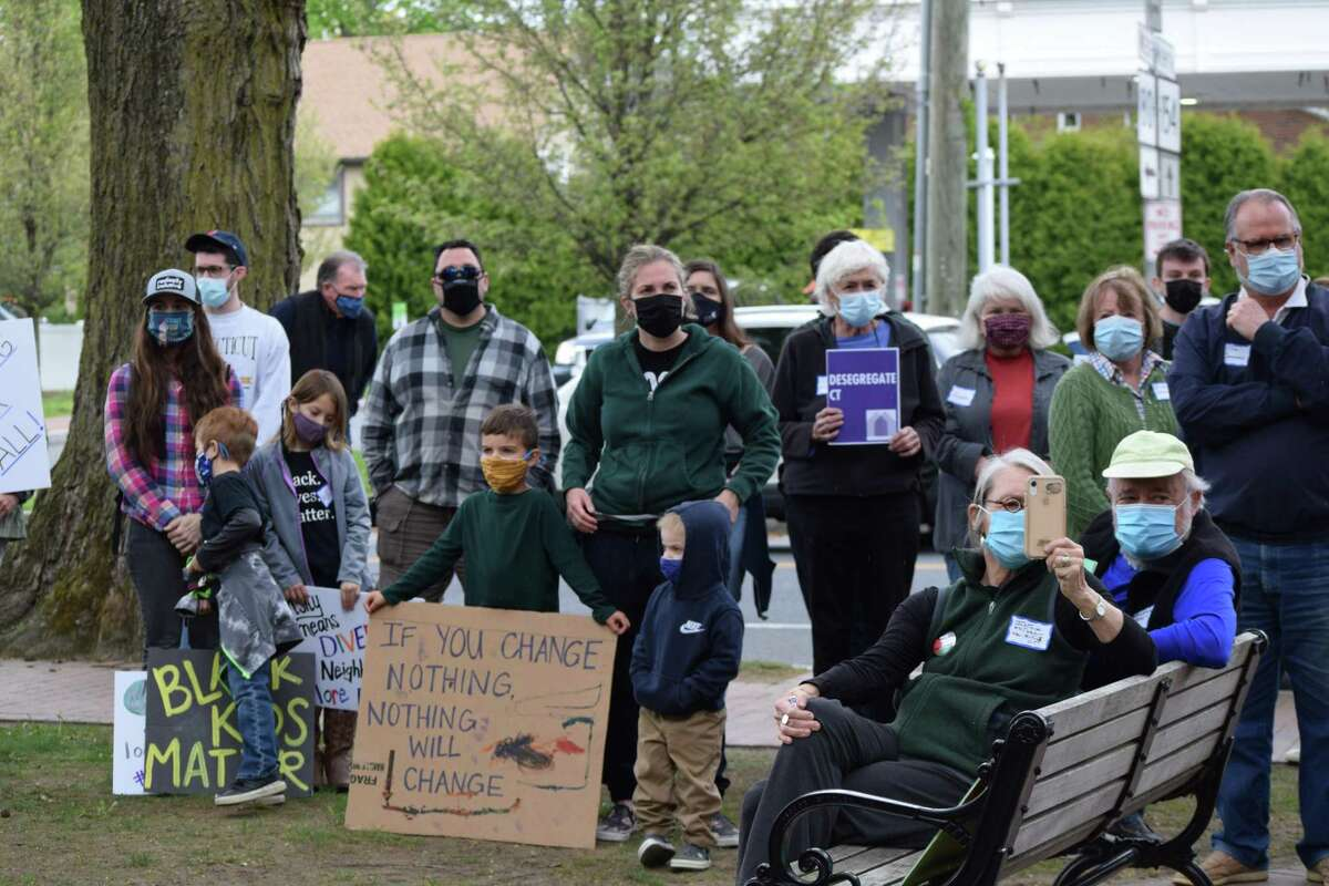 About 100 people attended the rally in Deep River, Conn. Saturday, May 8, 2021 advocating for affordable housing.