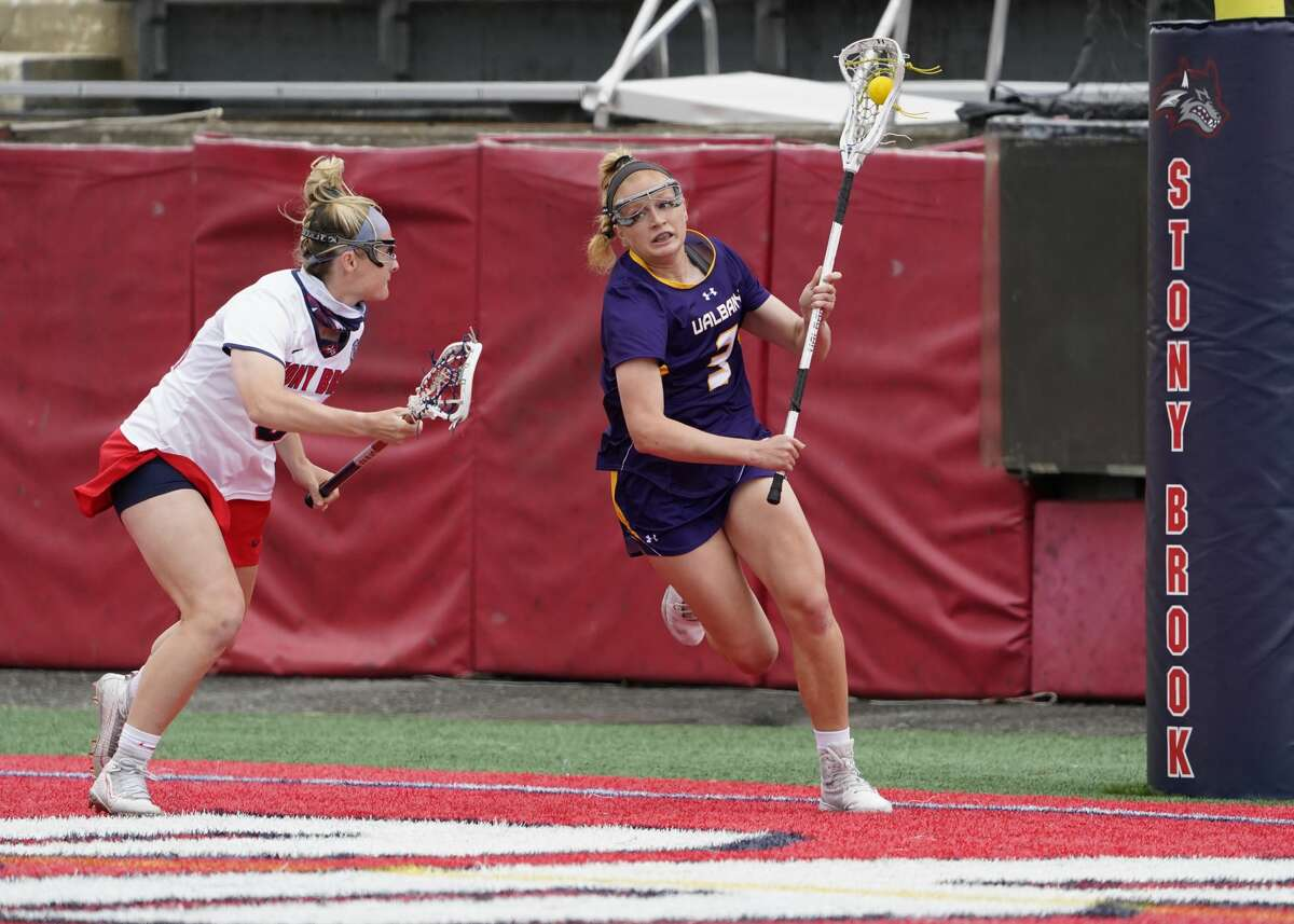 UAlbany's Madison Conway is defended by Stony Brook's Sydney Gagnon as she looks to make a play in the America East lacrosse championship in Stony Brook on Saturday, May 8, 2021. Conway scored a team-high four goals as the Great Danes were defeated by the Seawolves, 16-9.