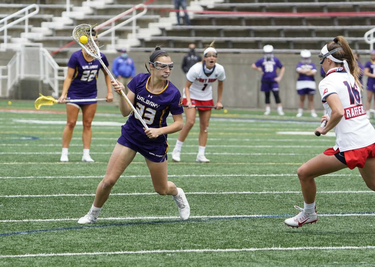 UAlbany's Sarah Falk looks to drive past Stony Brook's Siobhan Rafferty in the America East lacrosse championship in Stony Brook on Saturday, May 8, 2021. Falk scored three goals as the Great Danes were defeated by the Seawolves, 16-9.