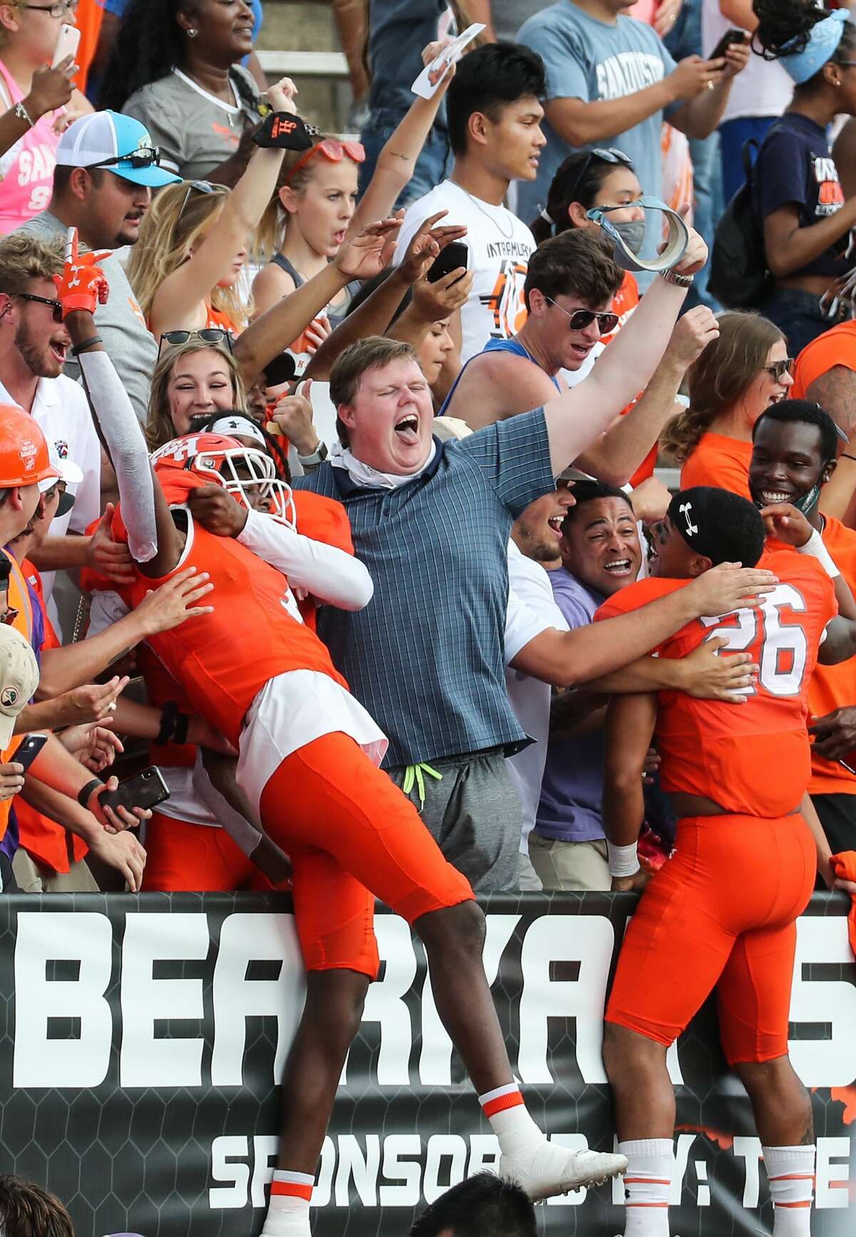Sam Houston State fans celebrate the Bearkats' 38-35 win over James Madison in a semifinal game in the NCAA FCS football playoffs on Saturday, May 8, 2021, in Huntsville.