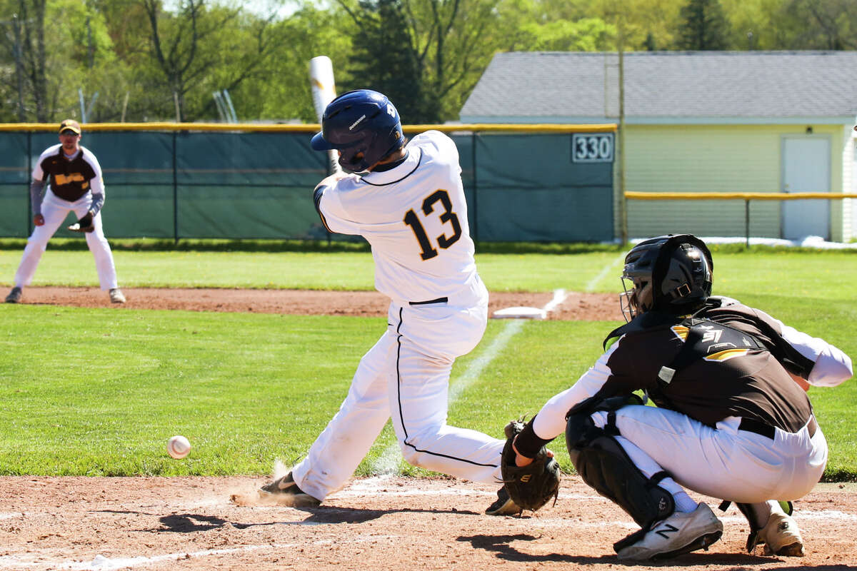 MIdland High Tim Vokol swings on a pitch during a game against Bay City Western Saturday, May 8, 2021 at Midland High School. (Doug Julian/for the Daily News)