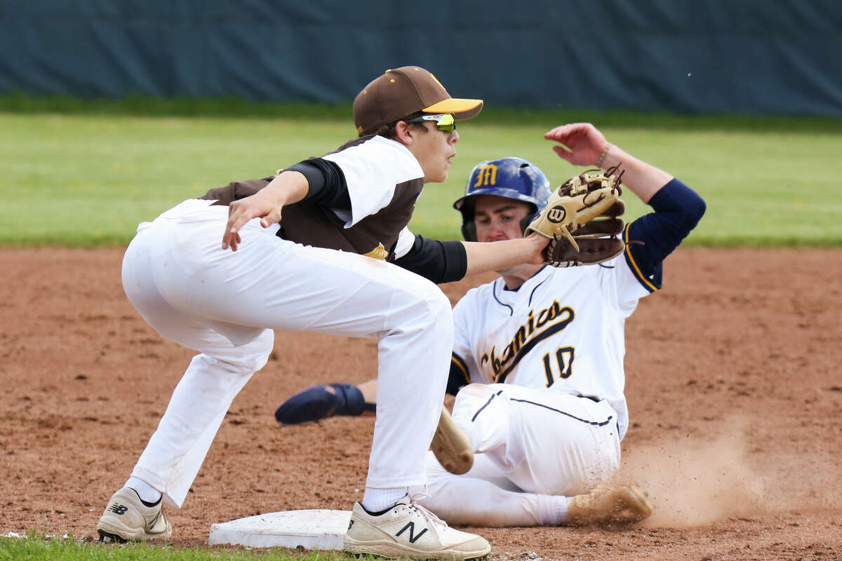 Midland's Al Money slides into third base during a game against Bay City Western Saturday, May 8, 2021 at Midland High School. (Doug Julian/for the Daily News)