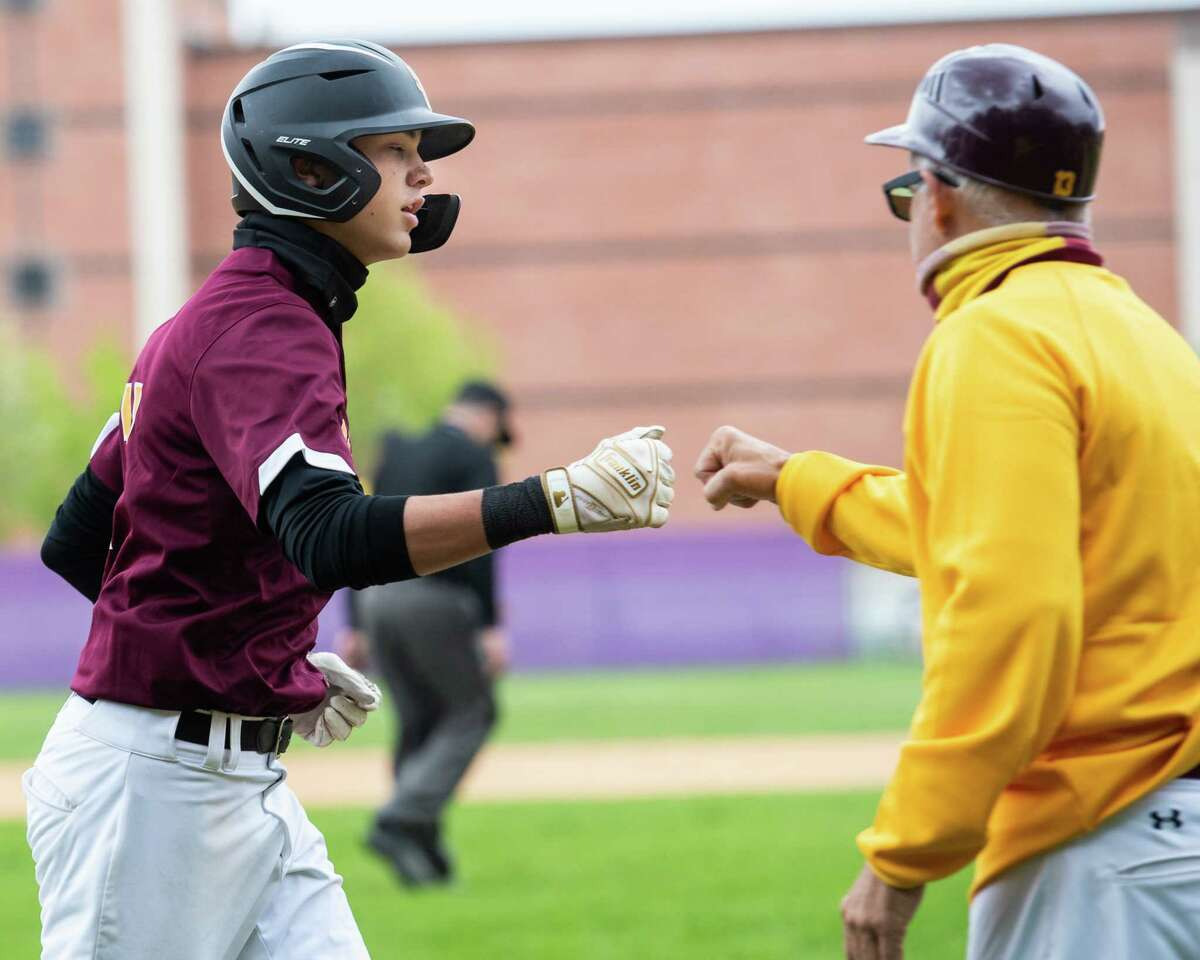 Colonie right fielder Zach Ashline fist bumps his coach, Kevin Halburian, after hitting his second home run of the game against Ballston Spa on May 8, 2021. He had six home runs for the season.