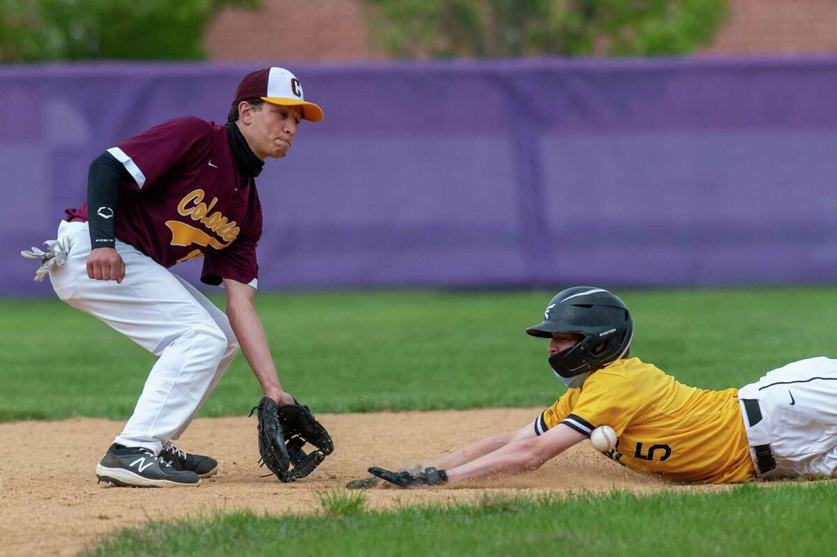 Colonie second baseman Brandon Baumann is a little late getting the ball and Ballston Spa baserunner Ryan Nagengast slides safely into second base during a game at Ballston Spa High School on Saturday, May 8, 2021. (Jim Franco/Special to the Times Union)
