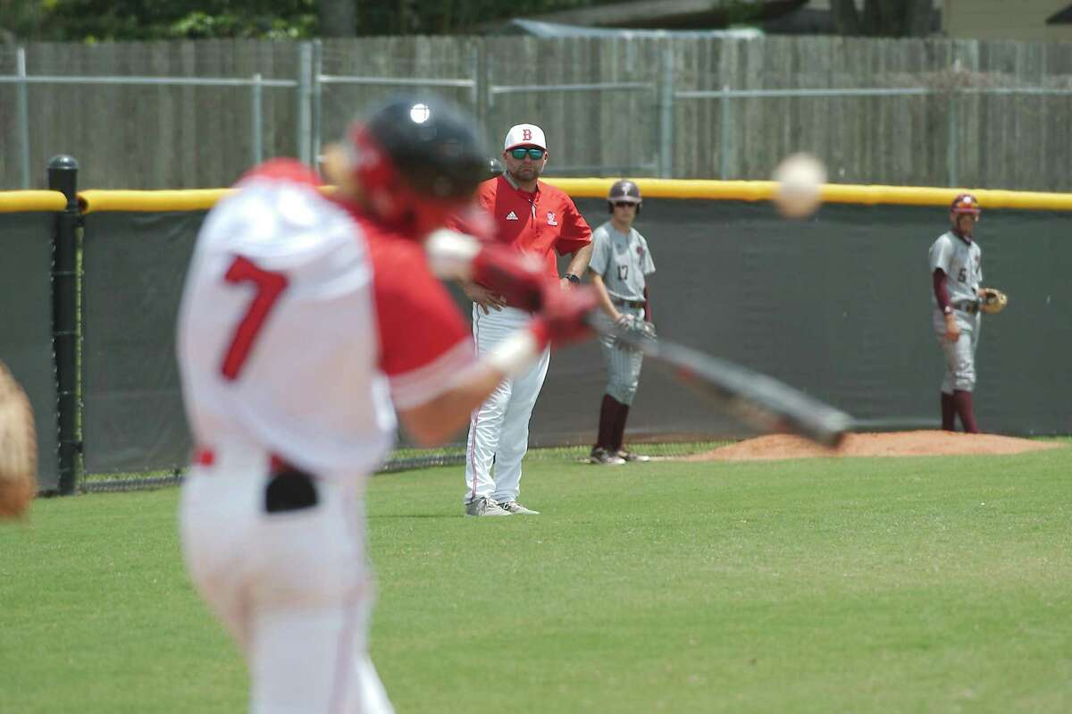 Clear Brook baseball coach Gene Flores watches as Clear Brook's Landon Hunt (7) bats against Pearland Saturday in a recent playoff game. The Wolverines took top honors on the all-District 24-6A baseball team.