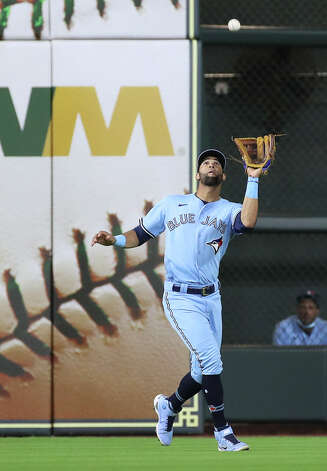 Toronto Blue Jays left fielder Lourdes Gurriel Jr. (13) catches a fly ball hit by Houston Astros catcher Martin Maldonado (15) during the seventh inning of an MLB game Saturday, May 8, 2021, at Minute Maid Park in Houston. Photo: Jon Shapley/Staff Photographer / © 2021 Houston Chronicle