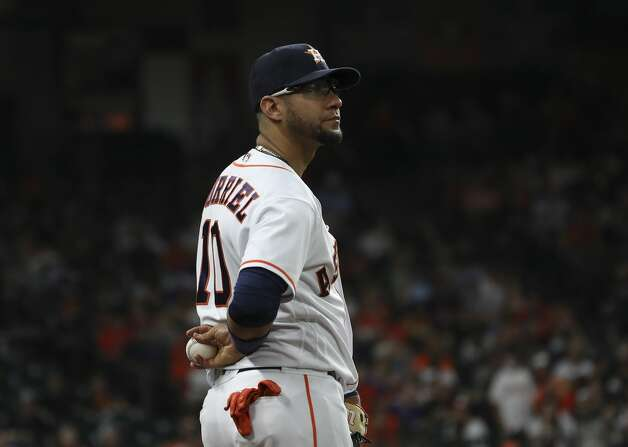 Houston Astros first baseman Yuli Gurriel (10) waits as the umpires check a replay during the eighth inning of an MLB game Saturday, May 8, 2021, at Minute Maid Park in Houston. Photo: Jon Shapley/Staff Photographer / © 2021 Houston Chronicle
