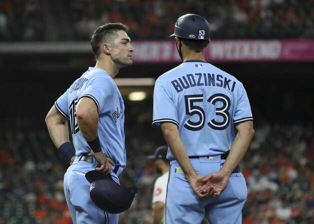 Toronto Blue Jays center fielder Randal Grichuk (15) talks with first base coach Mark Budzinski (53) as they wait for the results of a challenge during the eighth inning of an MLB game Saturday, May 8, 2021, at Minute Maid Park in Houston. Photo: Jon Shapley/Staff Photographer / © 2021 Houston Chronicle