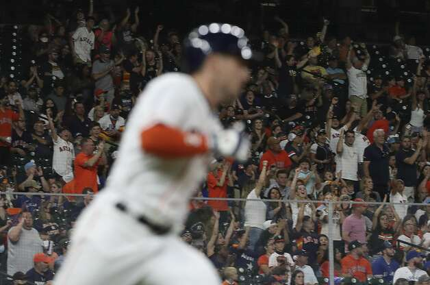 Fans cheer as Houston Astros third baseman Alex Bregman (2) doubles during the eighth inning of an MLB game Saturday, May 8, 2021, at Minute Maid Park in Houston. Photo: Jon Shapley/Staff Photographer / © 2021 Houston Chronicle